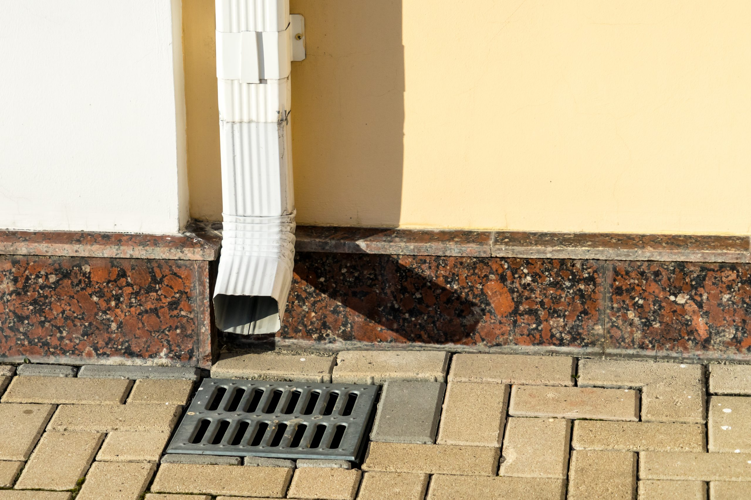 gutter drainage into grate in patio